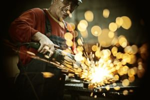 industrial-worker-cutting-and-welding-metal-with-many-sharp-sparks
