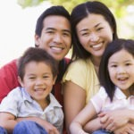 smiling Asian family visits optometrist regularly